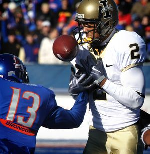 Boise State's Brandyn Thompson (13) causes Idaho's Maurice Shaw (2) to fumble during the first half of an NCAA college football game on Saturday, Nov. 14, 2009 in Boise, Idaho. Boise State recovered the ball. (Associated Press /  )