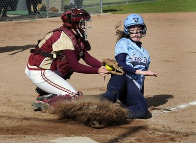 University catcher Alene Bethel tags out Central Valley's Jamie Belknap at home plate during the fifth inning. (Colin Mulvany / The Spokesman-Review)