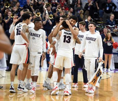 Gonzaga players celebrate their 83-71 victory against Baylor during the second round of the NCAA Tournament on Saturday, March 23, 2019, in Salt Lake City. (Colin Mulvany / The Spokesman-Review)
