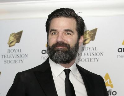 In this March 21, 2017, file photo, Rob Delaney poses for photographers upon arrival at the Royal Television Society Programme Awards in London. Delaney has announced the death of his infant son, Henry, from cancer, memorializing the boy as smart, funny, and mischievous in a Facebook post. (Tim Ireland / Associated Press)