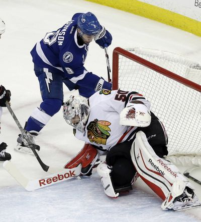 Lightning's Tyler Johnson scores past Corey Crawford in the second period. (Associated Press)