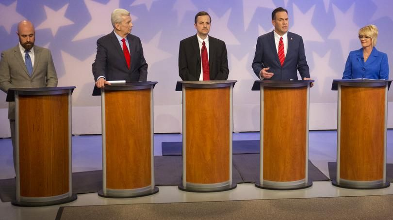 Russ Fulcher, third from right, speaks during a debate at the studios of Idaho Public Television in Boise on April 29, 2018, as five of his rivals for the GOP nomination for an open Idaho congressional seat look on. From left are Luke Malek, David Leroy, and Michael Snyder; from right are Alex Gallegos and Christy Perry. Not pictured is Nick Henderson, who didn't participate in the debate. (Otto Kitsinger / AP)