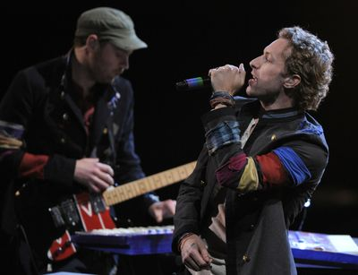 """""""Viva La Vida Or Death and All his Friends,"""" from Coldplay, left, and """"Tha Carter III,"""" from Lil Wayne, are also up for Grammys. (Mark Terrill / The Spokesman-Review)"""