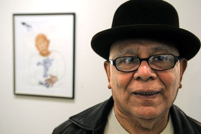 Prominent artist Ruben Trejo, who died Sunday in Spokane,  is pictured in January  2008 with a self-portrait. (Dan Pelle / The Spokesman-Review)