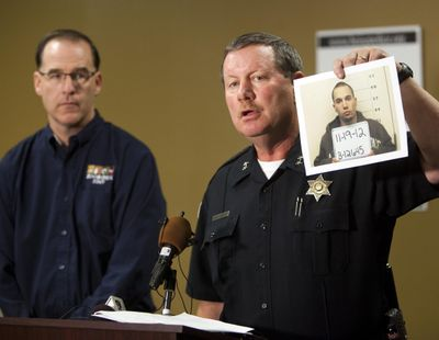 Boise Police Chief Michael Masterson, with Zoo Boise Director Steve Burns, announces the arrest of Michael J. Watkins, 22, Weiser, who investigators suspect killed a Patas monkey at Zoo Boise after breaking into the zoo early Nov. 17, at a news conference Monday Nov. 19, 2012 at the police headquarters in West Boise, Idaho. Chief Masterson said a tip provided by the community lead to the arrest. (Darin Oswald / Idaho Statesman)