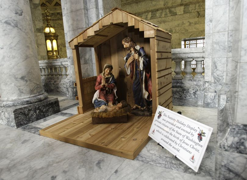 A Christian nativity scene is shown on display Monday, Dec. 1, 2008, at the Capitol in Olympia, Wash. The display is near a sign placed at the Capitol by the Wisconsin-based Freedom From Religion Foundation, which promotes the observance of the winter solstice and is critical of religious beliefs. (AP Photo/Ted S. Warren) (The Spokesman-Review)