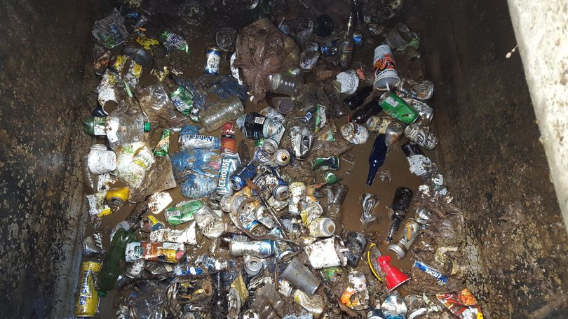 Garbage fills a large portion of a vault toilet at the Liberty Lake public access site managed by the Washington Department of Fish and Wildlife.  (Washington Department of Fish and Wildlife)