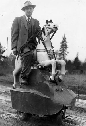 In this 1947 photo, Warner L. Keehn, Spokane inventor, rides his converted Merry-go-round horse near his home at E. 3134 35th.  The mechanical horse, geared to small gasoline engine mounted on rubber-tired wheels, gallops when the wheel turns and is controlled by the reins, just like a real horse. (Photo Archive/ Spokesman Review)
