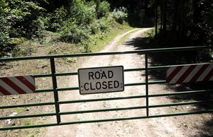 A gate blocks the road to the Brewer Mountain Route, one of four routes that are closed to motorists but which forest managers plan to open for disabled hunters who obtain special access permits. (Dan Pelle / The Spokesman-Review)