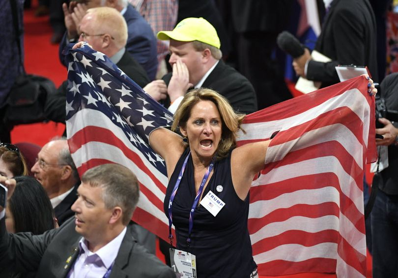 Delegates react as some delegates call for a roll call vote on the adoption of the rules during the opening day of the Republican National Convention in Cleveland, Monday, July 18, 2016. (AP Photo/Mark J. Terrill)