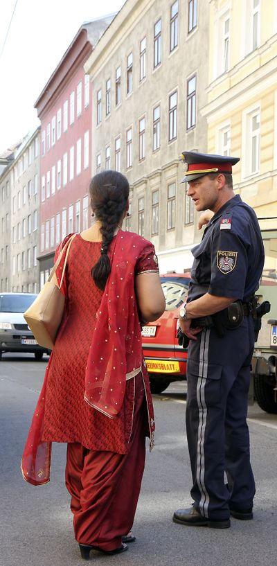 A woman talks to a policeman Sunday  near the Vienna temple.  (Associated Press / The Spokesman-Review)