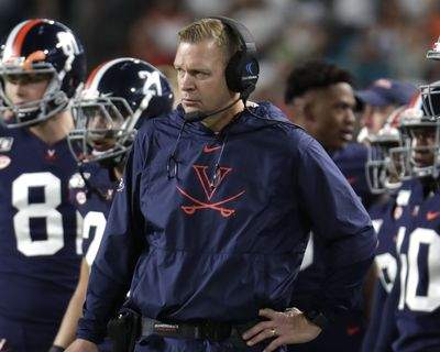 College football coaches, including Virginia's Bronco Mendenhall, are facing the daunting challenge of getting their players to maintain the required focus to prepare for season-openers when the prevailing question swirling around the sport is when, or if, the season will even be played because of the worldwide coronavirus pandemic.  (Lynne Sladky)