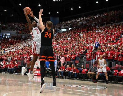 Washington State guard Noah Williams shoots over Oregon State forward Kylor Kelley during a Pac-12 Conference game Jan. 18 in Pullman.  (Colin Mulvany / The Spokesman-Review)
