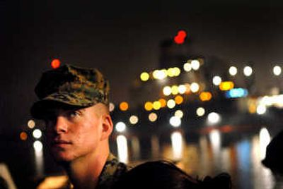 Awaiting deployment:  Robert Shipp  reflects on the dock at San Diego near the USS Germantown. The native of Hauser Lake, Idaho, was preparing to depart with his 1st Battalion, 5th Marine Regiment. His training indicates he's destined for Afghanistan.  (Brian Plonka / The Spokesman-Review)