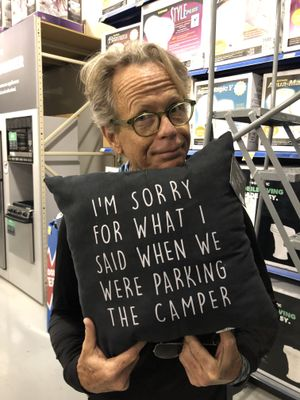 This pillow says it best: Parking can be a major pain point for couples traveling together. (Leslie Kelly)