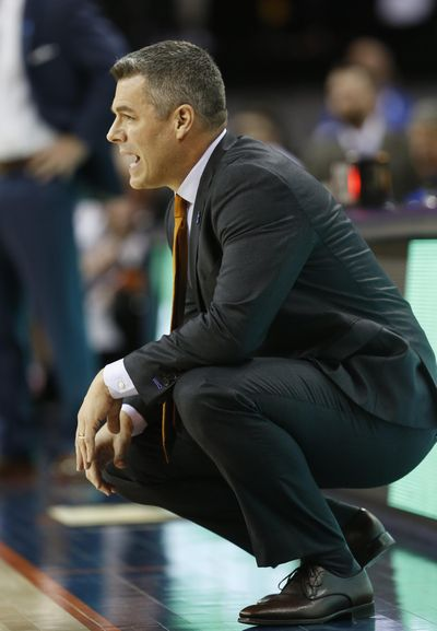 Virginia head coach Tony Bennett watches play during the first half of an NCAA basketball game in Charlottesville, Va., Saturday, Feb. 10, 2018. (Steve Helber / Associated Press)