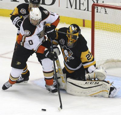 Anaheim's Corey Perry has his shot stopped by Pittsburgh goalie Marc-Andre Fleury during the second period. (John Heller / Associated Press)