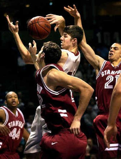 WSU player Robbie Cogwill goes into heavy Stanford traffic for a first-half offensive rebound Friday at the Spokane Arena.   (Brian Plonka / The Spokesman-Review)