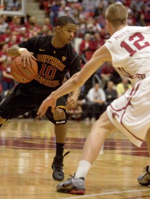 Southern California guard Maurice Jones (10) looks to drive against Washington State forward Brock Motum (12) during the first half of an NCAA college basketball game Thursday, March 3, 2011, in Pullman, Wash. Jones scored 16 points. Washington State won 85-77. (Dean Hare / Fr158448 Ap)
