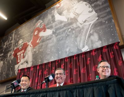 Patrick Chun, left, WSU's new athletic director, smiles with university president Kirk Schulz, center, and Phil Weiler vice president of marketing and communication, right, during an introductory press conference for Chun on Tuesday, January 23, 2018, in the Rankich Club Room at Martin Stadium in Pullman, Wash.  (Tyler Tjomsland / The Spokesman-Review)
