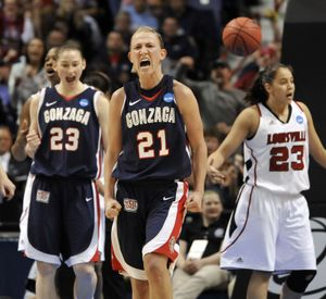 Gonzaga's Courtney Vandersloot (21) roars after being fouled on a jump shot she made in the secondhalf .  The Zags won 76-69 over Louisville, March 25, 2011, in the Spokane Arena. (Dan Pelle / The Spokesman-Review)
