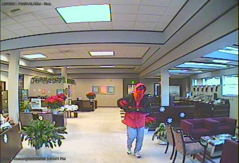 Police think the gunman who robbed a Northwest Boulevard bank last month also robbed a bank in December. Photos released today show a masked man in a red hooded coat with black trim robbing the Sterling Savings Bank, 3000 S. Grand Ave., at gunpoint Dec. 22. That same man also is pictured on Feb. 13 thought of robbed Chase Bank,  2215 W. Northwest Blvd., wearing a mask and a blue hooded coat with black trim. The robber is described as white with a medium build, 5-foot-10 to 6-feet tall. Anyone with information on a possible suspect is asked to call Detective Chet Gilmore at (509) 622-5874. (Spokane Police Department)