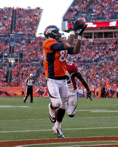 Broncos tight end Julius Thomas pulls in his second touchdown catch of the game during Denver's 41-20 win over the Cardinals. (Associated Press)