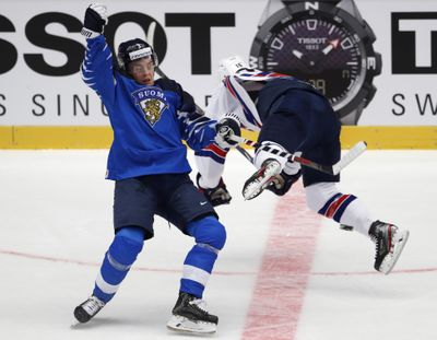 Finland's Anttoni Honka, left, collides with Alex Turcotte of the US, right, during the U20 Ice Hockey Worlds quarterfinal match between Finland and the United States in Trinec, Czech Republic. Finland won 1-0. (Petr David Josek / Associated Press)