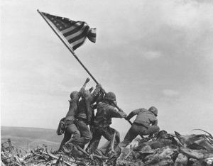 Joe Rosenthal won a Pulitzer Prize for this image of six World War II servicemen raising an American flag over battle-scarred Iwo Jima, taken on Feb. 23, 1945.   (File Associated Press / The Spokesman-Review)