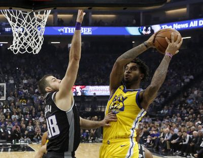 Golden State Warriors forward Marquese Chriss, right, goes to the basket against Sacramento Kings forward Nemanja Bjelica during the first quarter of an NBA basketball game in Sacramento, Calif., Monday, Jan. 6, 2020. (Rich Pedroncelli / Associated Press)