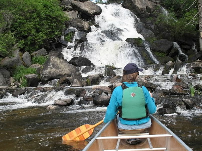 Canoeists enjoy the waterfalls on the West Branch of the Little Spokane River. The 50-foot Exley Falls, which tumble into Horseshoe Lake in Pend Oreille County just north of Eloika Lake, run strong in spring but ease back a trickle in summer. (Rich Landers)