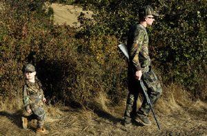 """Ryan """"JR"""" Elkins Jr. of Spokane Valley bucks a national trend by following his father on a turkey hunt in October. Nationally, the number of youths being introduced to hunting by their parents is on the decline.  (Holly Pickett / The Spokesman-Review)"""