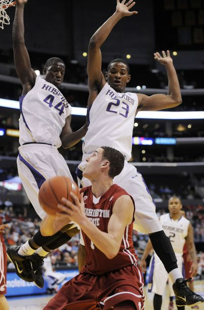 Washington's Darnell Gant, left, and C.J. Wilcox defend against Washington State's Klay Thompson, who burned the Huskies for a Pac-10 tournament-record 43 points on Thursday. (Associated Press)