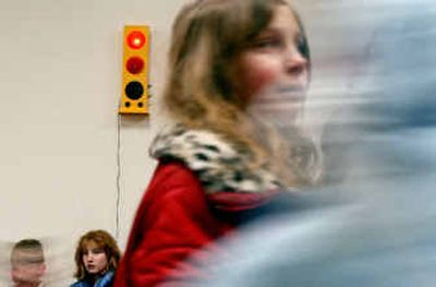 Students at Athol Elementary School are reminded at lunchtime to quiet down when the light on the Talk Light in the cafeteria turns from green to red.   (Kathy Plonka / The Spokesman-Review)