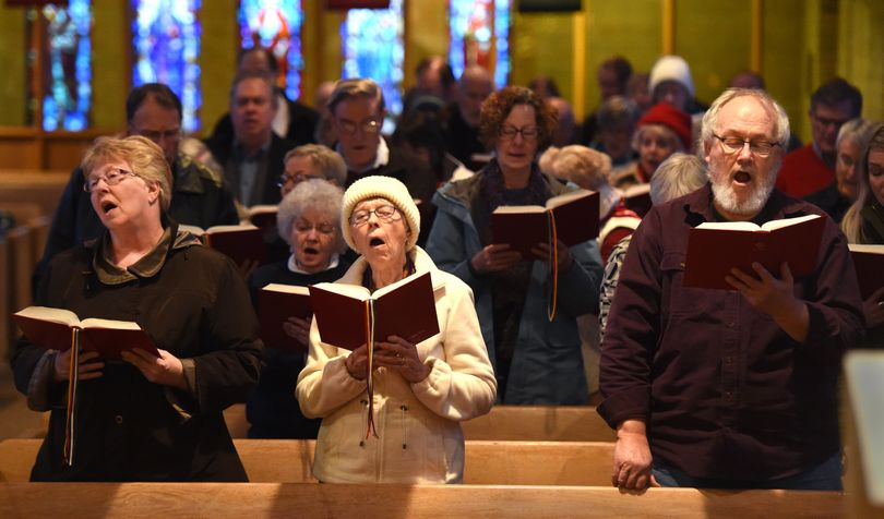 From left, Sheri Decker, Nancy Decker and Ernie Buckler sing Christmas carols in the front row at Central Lutheran Church in downtown Spokane, accompanied by the 1966 Aeolian-Skinner pipe organ Saturday during the Organ Walk. (Jesse Tinsley / The Spokesman-Review)