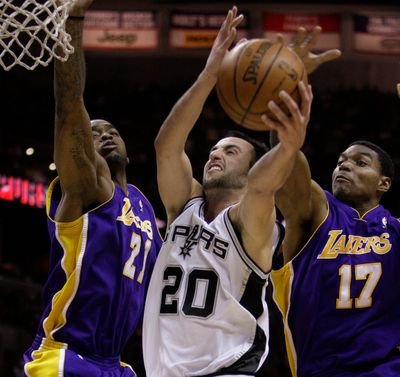 Lakers forward Josh Powell, left, and center Andrew Bynum try to slow down Spurs guard Manu Ginobili in NBA action on Wednesday. (Associated Press / The Spokesman-Review)
