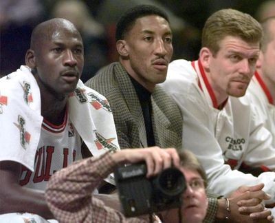 Chicago Bulls' injured player Scottie Pippen sits on the bench between teammates Michael Jordan, left and Joe Kleine in the first period against the Milwaukee Bucks on Dec. 5, 1997, in Chicago. (MICHAEL S. GREEN / AP)