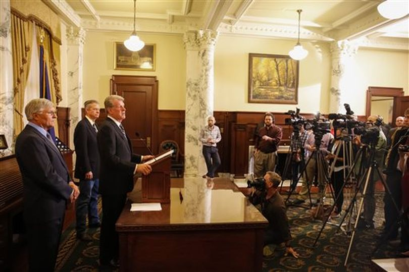 Idaho Gov. Butch Otter calls a special session of the Idaho Legislature Wednesday, at a news conference in his office; the session will be limited to addressing a crisis in Idaho's child support enforcement system. (AP / Otto Kitsinger)