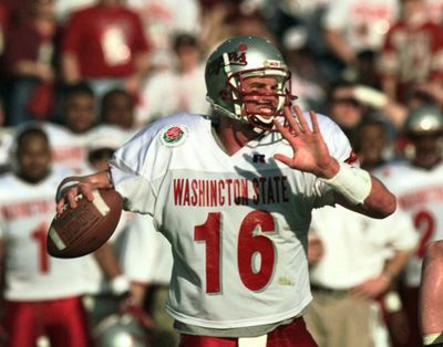 Washington State's Ryan Leaf looks downfield for a receiver in the first quarter of the 84th Rose Bowl in Pasadena, Calif., Jan. 1, 1998. (ERIC DRAPER / Associated Press)