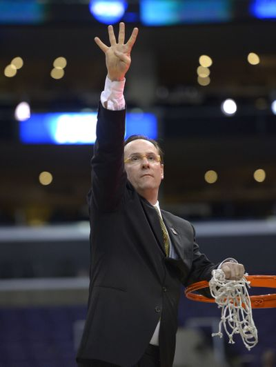 Wichita State coach Gregg Marshall signals that his team is headed to the Final Four. (Associated Press)