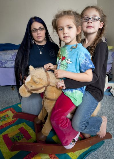 Crystal Watkins,  a single working mother of two girls, Andrea, 4, and Autumn, 6, is in danger of losing her child care subsidy. (Colin Mulvany)