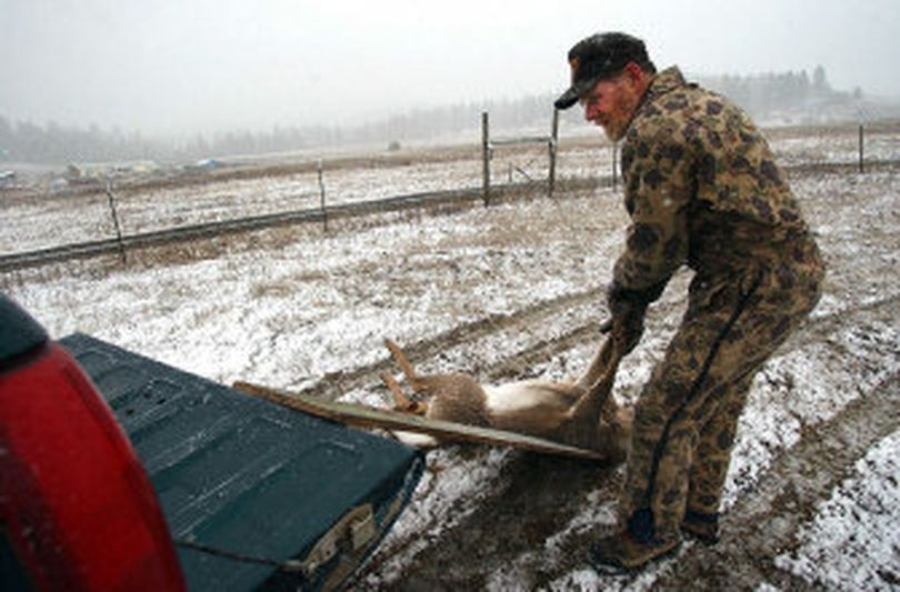 Jim Kujala loads a dead deer into a truck near Chattaroy.  Kujala is a state-certified Inland Northwest Wildlife Council volunteer who  collects roadkill and salvages the meat for the Union Gospel Mission.   (Liz-Anne Kishimoto / The Spokesman-Review)