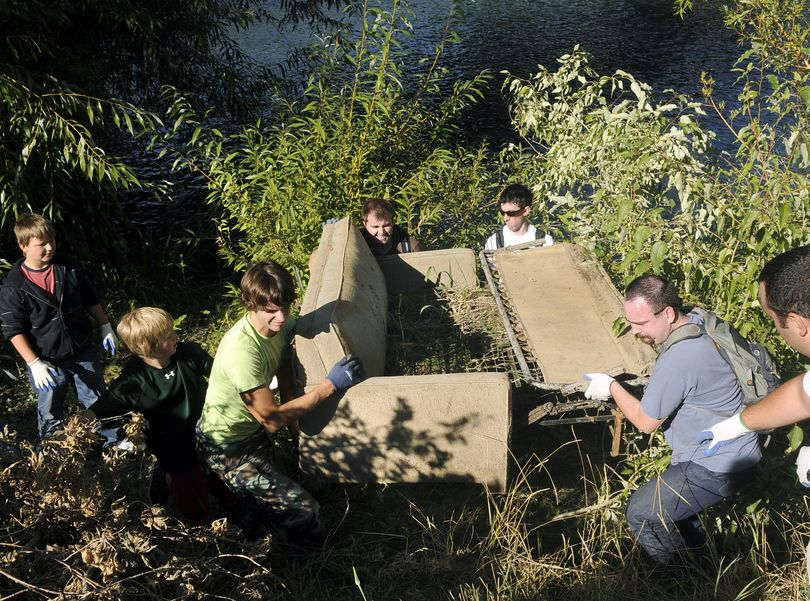 Bubba Ferguson, Tyler Zandhuisen, Chris Lewis, Kaleb Allen, Aaron Danneker and Loren Vanden Berg muscle up a hide-a-bed couch from the banks of the Spokane River near  South Riverton and Desmet during the Seventh Annual Spokane River Clean-Up.  (Dan Pelle / The Spokesman-Review)