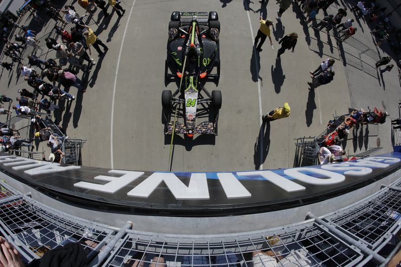 In this photo taken with a fisheye lens, the car driven by Townsend Bell is pulled to the pit before the start of the final practice session for the Indianapolis 500 auto race at Indianapolis Motor Speedway in Indianapolis, Friday, May 22, 2015. (Darron Cummings / Associated Press)