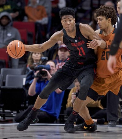 Gonzaga forward Rui Hachimura, left, posts up against Texas forward Jericho Sims during the second half of an NCAA college basketball game in the Phil Knight Invitational tournament in Portland, Ore., Sunday, Nov. 26, 2017. (Craig Mitchelldyer / Associated Press)