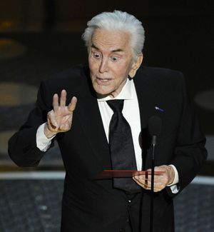 Actor Kirk Douglas presents the award for best supporting actress during the 83rd Academy Awards on Sunday, Feb. 27, 2011, in the Hollywood section of Los Angeles. (AP Photo/Mark J. Terrill) ((AP Photo/Mark J. Terrill) / Associated Press)