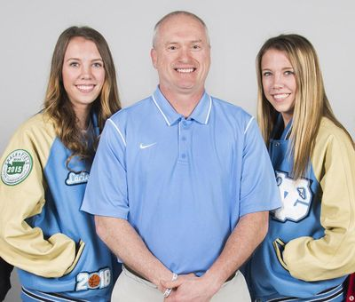 Lacie Hull, left, and twin sister Lexie Hull, right, with CV coach Freddie Rehkow, will try out for the USA women's basketball U17 national team. (Dan Pelle / The Spokesman-Review)