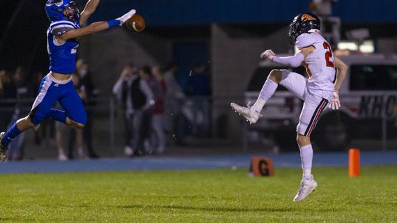 Coeur d'Alene's Tanner Langley blocks the punt of Post Falls' Cole Rutherford. Langley scooped up the block and went 17 yards for a score in the Vikings' 48-7 win on Friday night.  (Cheryl Nichols/For The Spokesman-Review)