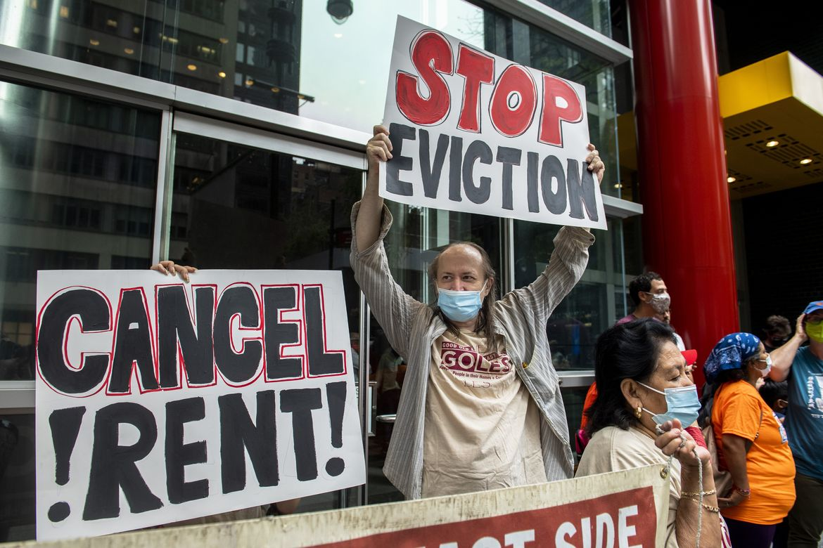 Housing advocates protest the lifting of the eviction moratorium