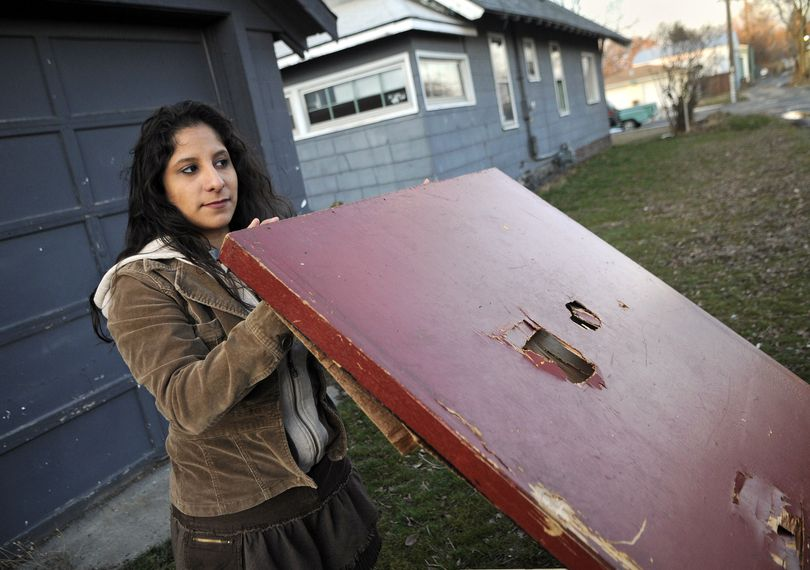 Veronica Evans had her front door kicked in recently in the Chief Garry Park area. After she replaced the door, someone has tried to enter her home twice more. (Dan Pelle)